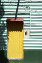 Argentina, Buenos Aires, La Boca, Colorful facade of house in green and yellow - IGGF00790