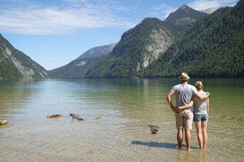 Germany, Bavaria, Koenigssee, couple standing in lake - DLF00027