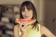 Beautiful woman eating slice of watermelon - MCF00070
