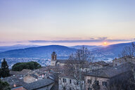 Italy, Umbria, Perugia, view of the city valley and its surrounding hills at sunset - FLMF00141