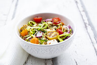 Bowl of zoodles with fried tofu, red quinoa, red onions and tomatoes - LVF07814