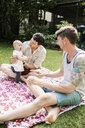 Gay couple enjoying with baby girl at yard - ASTF04061