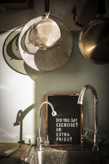 Board with funny text at the kitchen sink - MJRF00048