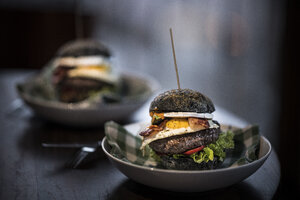 Black hamburgers with egg and bacon - MJRF00072