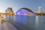 Spain, Valencia, lighted L'Hemisferic and Palau de les Arts Reina Sofia at City of Arts and Sciences - KEB01163