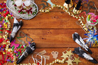 Directly above shot of Christmas decorations on wooden table - ASTF04707