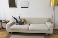 Little blond girl playing on the couch at home - PSIF00246