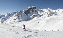 Switzerland, Grand Saint Bernard Pass, Pain de Sucre, Mont Fourchon, woman ski touring in the mountains - ALRF01405