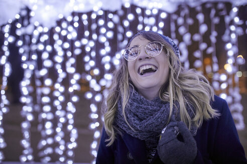 Portrait of laughing young woman in winter decoration - ZEDF01907