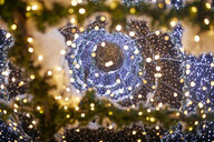 Worm's eye view of illuminated festive Christmas decoration - ZEDF01916