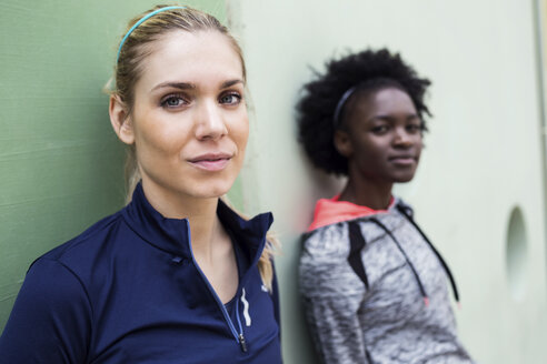 Lleida, Catalonia, Spain,Portrait of two sporty young women looking at camera in the street. - JSRF00136