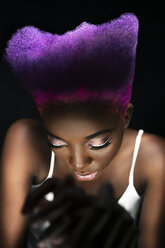 Portrait of eccentric young woman with pink and purple dyed hair - DMOF00139