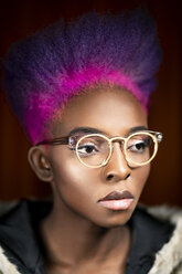Portrait of young woman with pink and purple dyed hair wearing fashionable glasses - DMOF00142