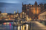 Germany, Hamburg, Elbarkaden and Maritime Museum at blue hour - KEB01182