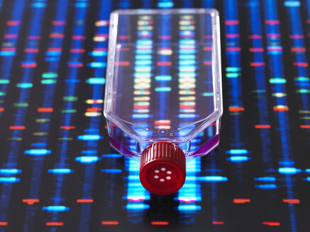 Genetic Engineering, culture jar with a DNA profiles on a screen in the background, illustrating gene editing - ABRF00337