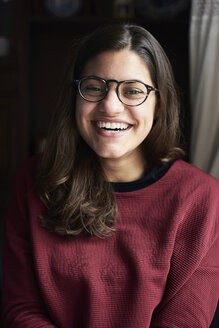 Portrait of laughing young woman wearing glasses - IGGF00814