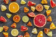 Sliced citrus fruits on slate - SARF04124