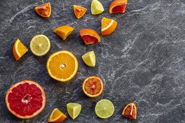 Sliced citrus fruits on slate - SARF04127