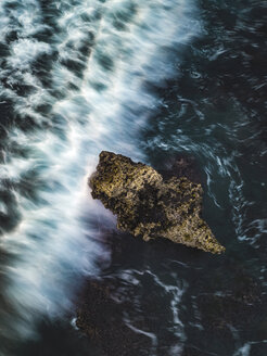 Indonesia, Bali, Batu Bolong beach, Aerial view of an ocean wave at a rock - KNTF02705