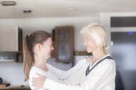 Mother and adult daughter having fun together at home - SGF02300