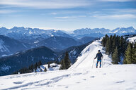 Germany, Bavaria, Brauneck, man on a ski tour in winter in the mountains - DIGF05943