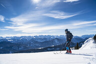 Germany, Bavaria, Brauneck, man on a ski tour in winter in the mountains - DIGF05946