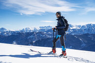 Germany, Bavaria, Brauneck, man on a ski tour in winter in the mountains - DIGF05949