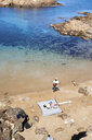 Spain, Menorca, family relaxing on the beach - IGGF00905