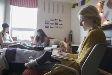 Female college students studying in dorm room - HEROF24714