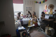Female college students studying in dorm room - HEROF24717