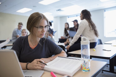 Focused female college student studying in classroom - HEROF24747