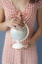 Woman holding globe, close up - KNS05693