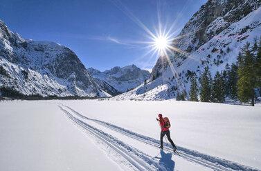 Austria, Tirol, Riss Valley, Karwendel, cross country skier in winter landscape - MRF01919