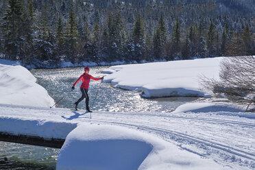 Germany, Bavaria, Wallgau, Isar Valley, Canada trail, cross country skier in winter landscape - MRF01922