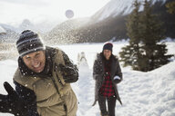 Couple enjoying snowball fight - HEROF25125