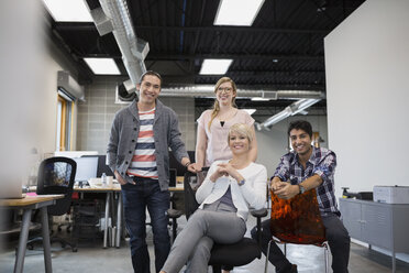 Portrait of confident business people in office - HEROF25365