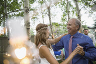 Bride and father dancing at backyard wedding reception - HEROF25524