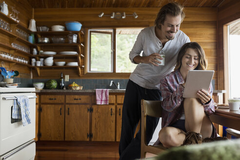 Young couple using digital tablet in cabin kitchen - HEROF25677
