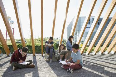 Students doing homework under wood beam walkway - HEROF26035