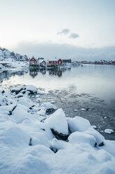 Scenic snowy view waterfront fishing village, Reine, Lofoten Islands, Norway - CAIF22631