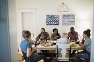 Friends enjoying dinner party at dining table - HEROF26056