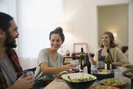 Friends drinking wine and enjoying dinner party - HEROF26089