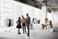 Fashion stylists and businessman meeting in studio - HEROF26268