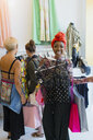 Portrait happy, enthusiastic young woman shopping in clothing store - CAIF22741