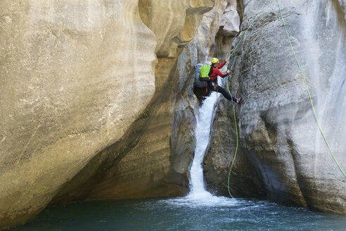Hiker rappelling on Pyrenees over river - CAVF61579