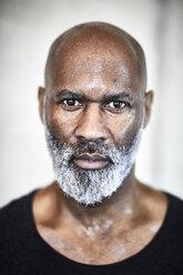 Portrait of sweating bald man with grey beard - FMKF05423