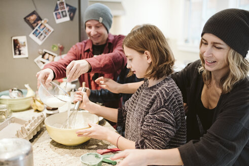 Family baking in kitchen - CAIF22888