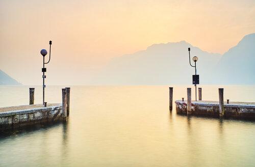 Italy, Torbole, Lake Garda, jetties at sunset - MRF01935