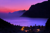 Italy, Torbole, view to Lake Garda at sunset - MRF01941