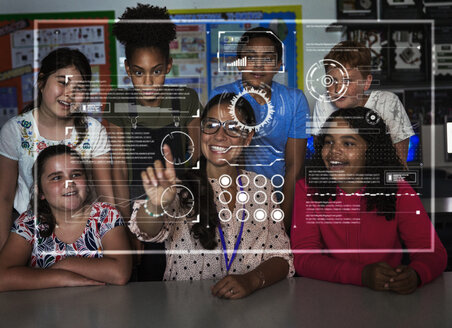 Teacher and junior high school students using futuristic touch screen in classroom - CAIF22933